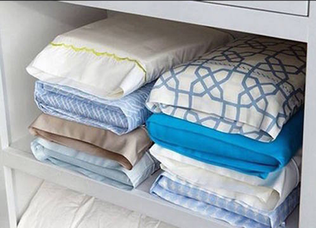 organising bed sheets using pillow cases