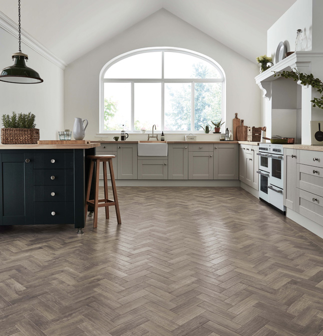 create a modern parquet look with the ashy grey tones of storm oak luxury vinyl flooring featuring a hand scraped emboss that gives an authentic look - Kitchen Flooring Ideas