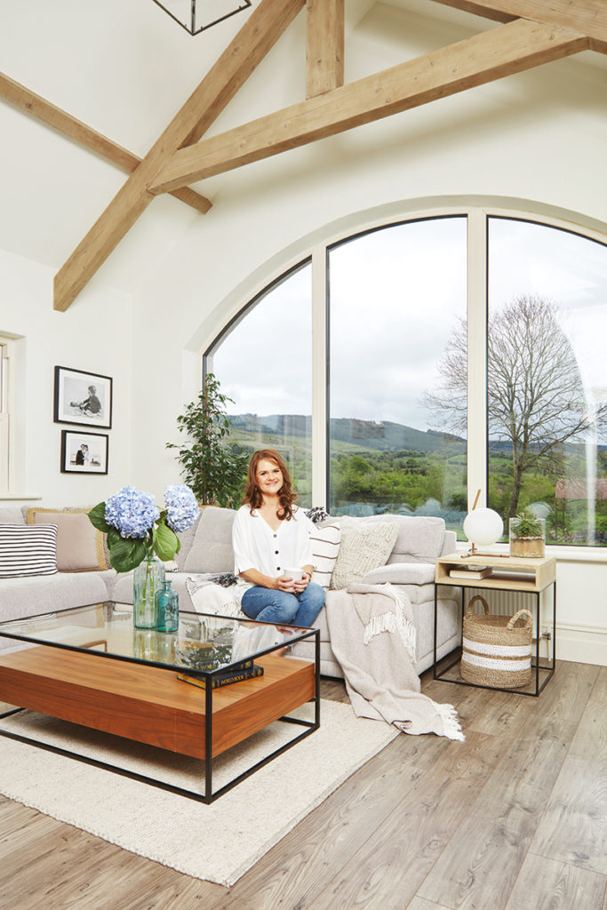 Caroline Hassett's Tipperary new build, A House by The Trees - caroline in living room