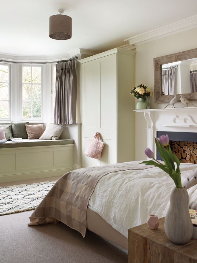 "The couple calls this guest room the Cotswolds room, as it's modelled on weekends spent in cottages there, where they were inspired by natural textures, tweed fabrics and the dusky grey and yellow colour palette you'll find in this part of the world. ""We had the window seat built into enjoy the view and make use of the space in a different way,"" says Sarah. Find a similar Berber rug at Sostrene Grene, Monet Pale from Fleetwood's Vogue collection (Fleetwood.ie) is a similar shade to the woodwork colour"