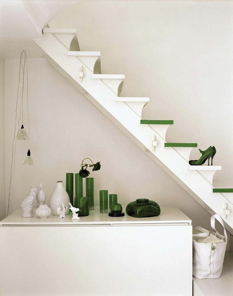 white and green interior with stairs
