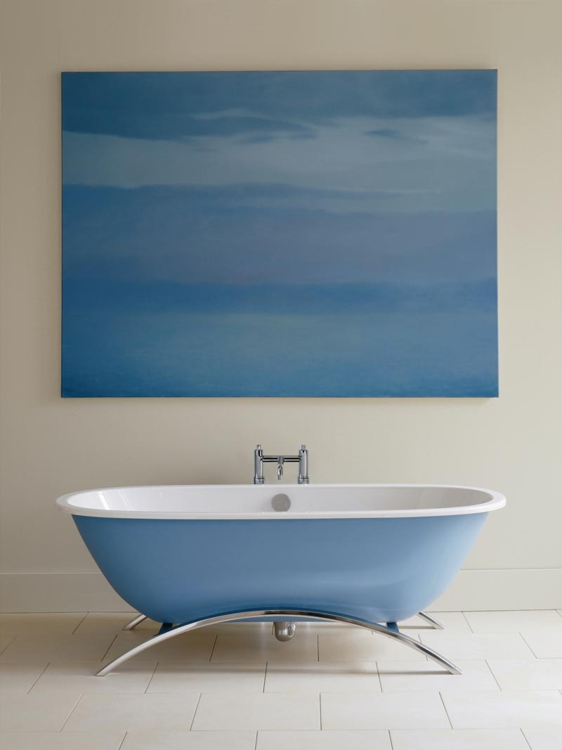 blue and white bathroom with freestanding bath