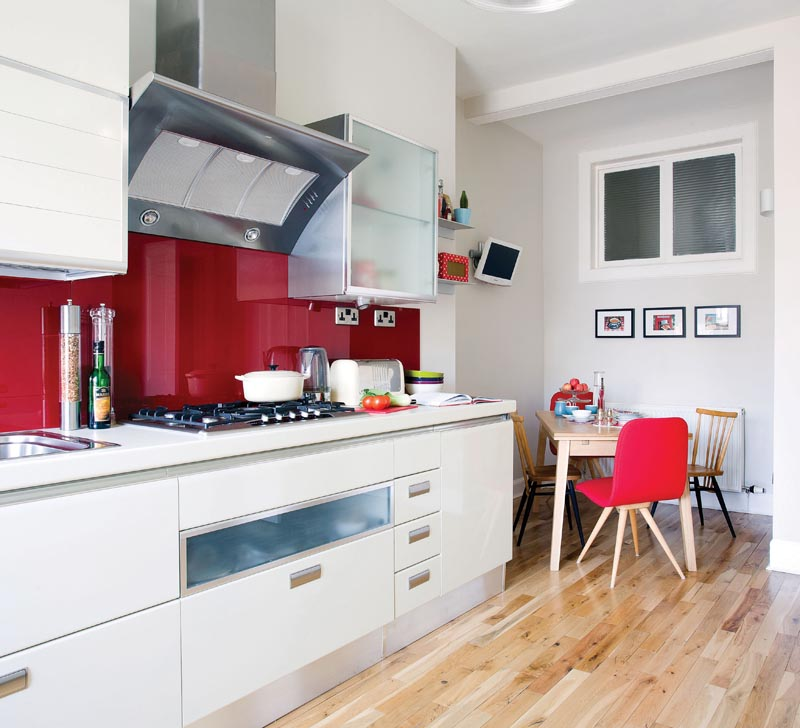 white gloss kitchen with red colourglass splashback